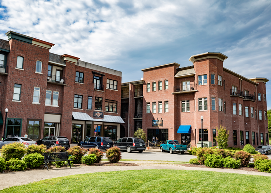 Exterior of Pleasant View Village showing restaurants, retail and residential spaces Monday, May 6, 2019.
