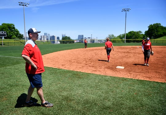 Belmont softball coach Brian Levin encourages his players during practice Monday.