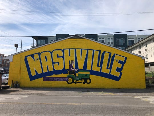 A new mural on the side of Colonial Liquors in Nashville depicts George Jones on his riding lawn mower.