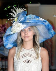 Stacey Rhodes Boutique stylist Ginger Johnson models this Carol Carr hat that costs $679.