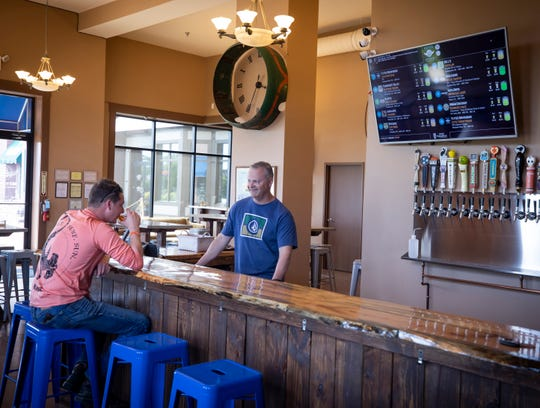 John Nelson, right, owner of Flytes Brewhouse in the Pleasant View Village, chats with customer Josh Whittenburg Monday, May 6, 2019.