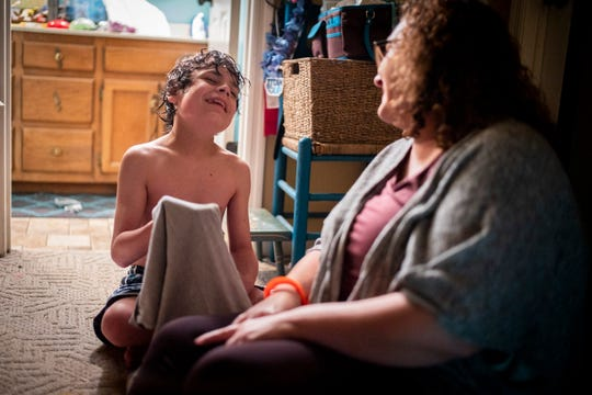 Mollie Mills Sheppard chats with her 11-year-old son Dax after his bath at their home in Gallatin, Tenn., Thursday, May 2, 2019.