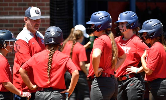Belmont softball coach Brian Levin talks with his team during a break in practice Monday.