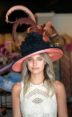 Stacey Rhodes Boutique stylist Ginger Johnson models this Carol Carr hat that costs $769.