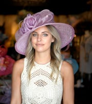 Stacey Rhodes Boutique stylist Ginger Johnson models this hat that costs $89.