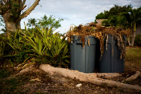 Garbage cans hold yard waste at a community garden on 98th Avenue North in Naples Park on Tuesday, May 7, 2019. The garden previously used a compost system, but according to Sean McCabe it was removed after neighbors complained that the compost was attracting rodents.