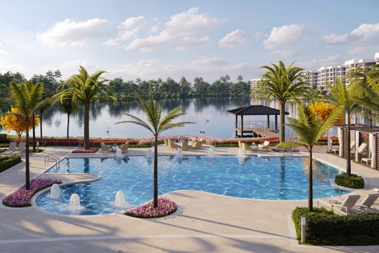 The clubhouse pool at Moorings Park Grande Lake features poolside cabanas and overlooks a 28-acre lake with golf course views beyond.