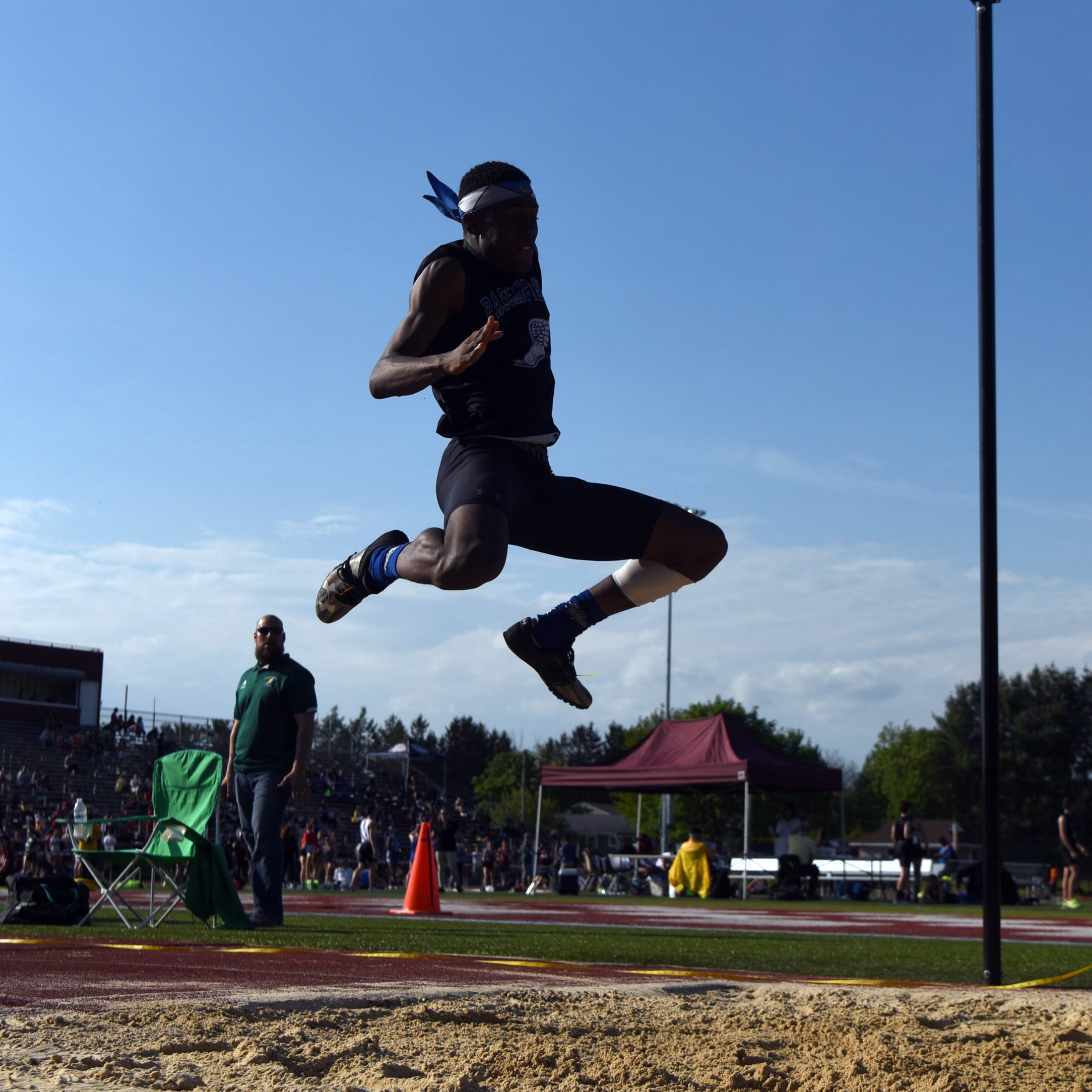 Day one of the Passaic County Track and Field Championships were held at Wayne Hills High School on Tuesday, May 7, 2019.  Joel Ingram soars through the air in his winning triple jump of 46 feet 11 inches.