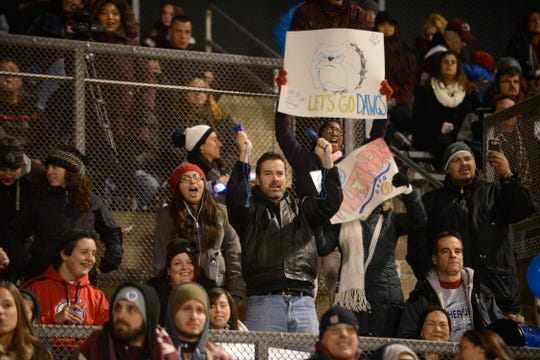 Parents cheer during a 2014 youth football game between the Rutherford Bulldogs and Elmwood Park Bombers.