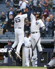 New York Yankees first baseman Luke Voit (45) celebrates with catcher Gary Sanchez (24) after hitting a two run home run against the Seattle Mariners during the first inning at Yankee Stadium.