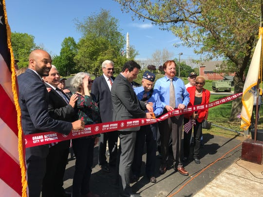 Paterson Mayor Andre Sayegh, cutting the ribbon on the new driveway at Veterans Memorial Park at Hayden Heights in Paterson.