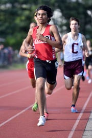 Day one of the Passaic County Track and Field Championships were held at Wayne Hills High School on Tuesday, May 7, 2019.  Jesse Campoverde placed first in the 1600 meter finals.
