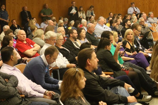 Neighbors who oppose construction of the pingpong club on Colfax Road filled rows of the township's courtroom at a public hearing held by the Zoning Board of Adjustment on May 6.