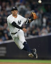 New York Yankees shortstop Thairo Estrada (30) throws out Seattle Mariners shortstop Tim Beckham (not pictured) on a ground ball during the sixth inning at Yankee Stadium.