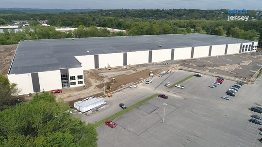 Kering S.A., the French parent company of luxury brands that include Alexander McQueen, Gucci and Yves Saint Laurent, is leasing a gigantic office building and warehouse on Wayne's border with Totowa.