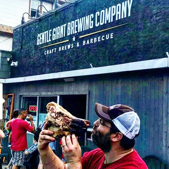 Gentle Giant Brewing Company is a brewery that also serves barbecue, including whole pig roasts.