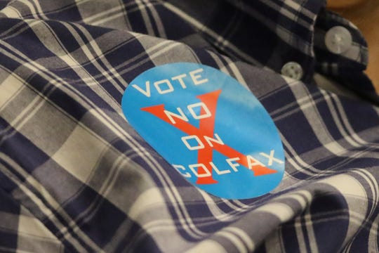 Opponents of the plan to build the pingpong club wore these stickers at the last hearing. The application has since been withdrawn.