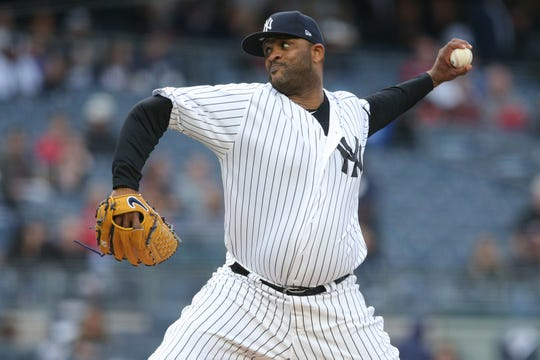 New York Yankees starting pitcher CC Sabathia (52) throws the ball against the Seattle Mariners during the second inning at Yankee Stadium.