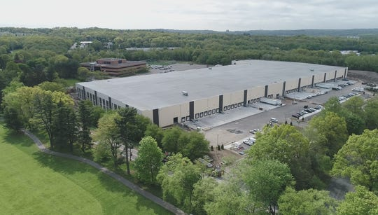 Kering S.A., which owns several luxury brands, including Gucci, will take occupancy of this office building and warehouse on the south border of Wayne next year.