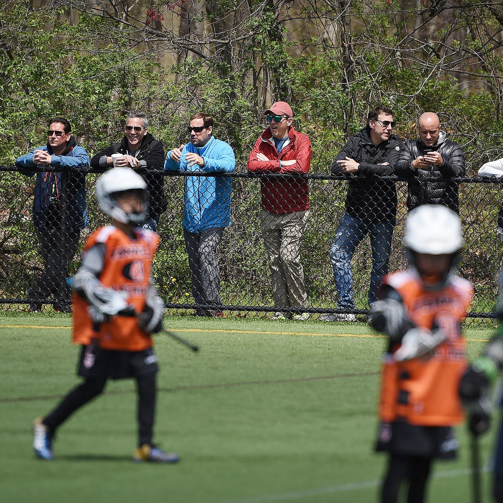 Parents of the players watch during the 6th Annual Ted Hughes Memorial BattleLax Tournament in 2018.
