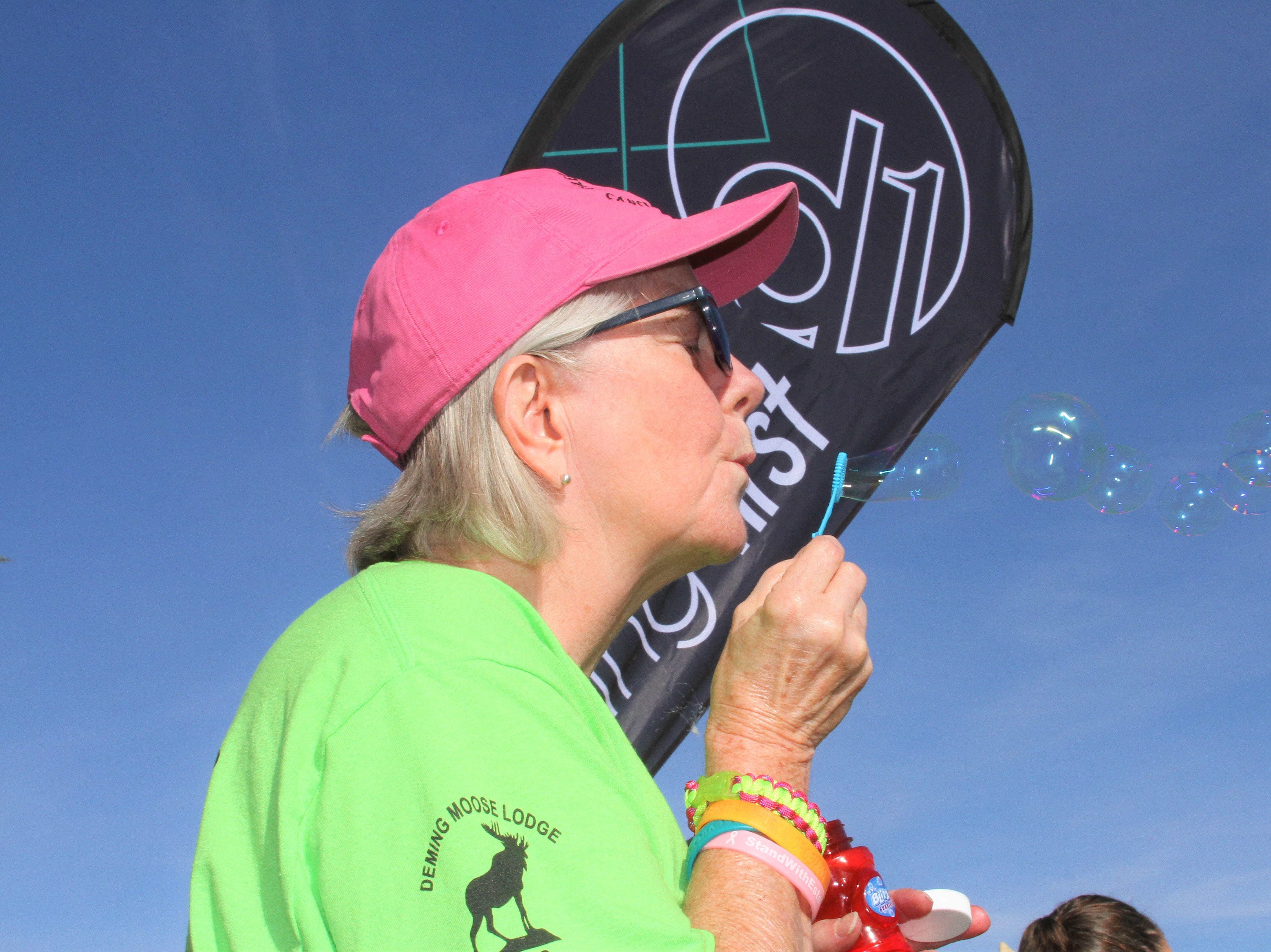 Mary Upton of First Baptist Church blowing bubbles as she waits for the Celebration of Life to begin.