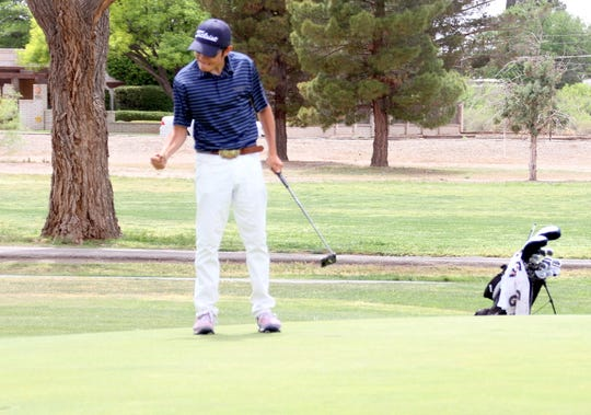 Wildcat senior Nemo Perales gives a fist-pump after closing out his championship round on Monday at the District 3-5A Golf Tournament at Rio Mimbres Golf Course.