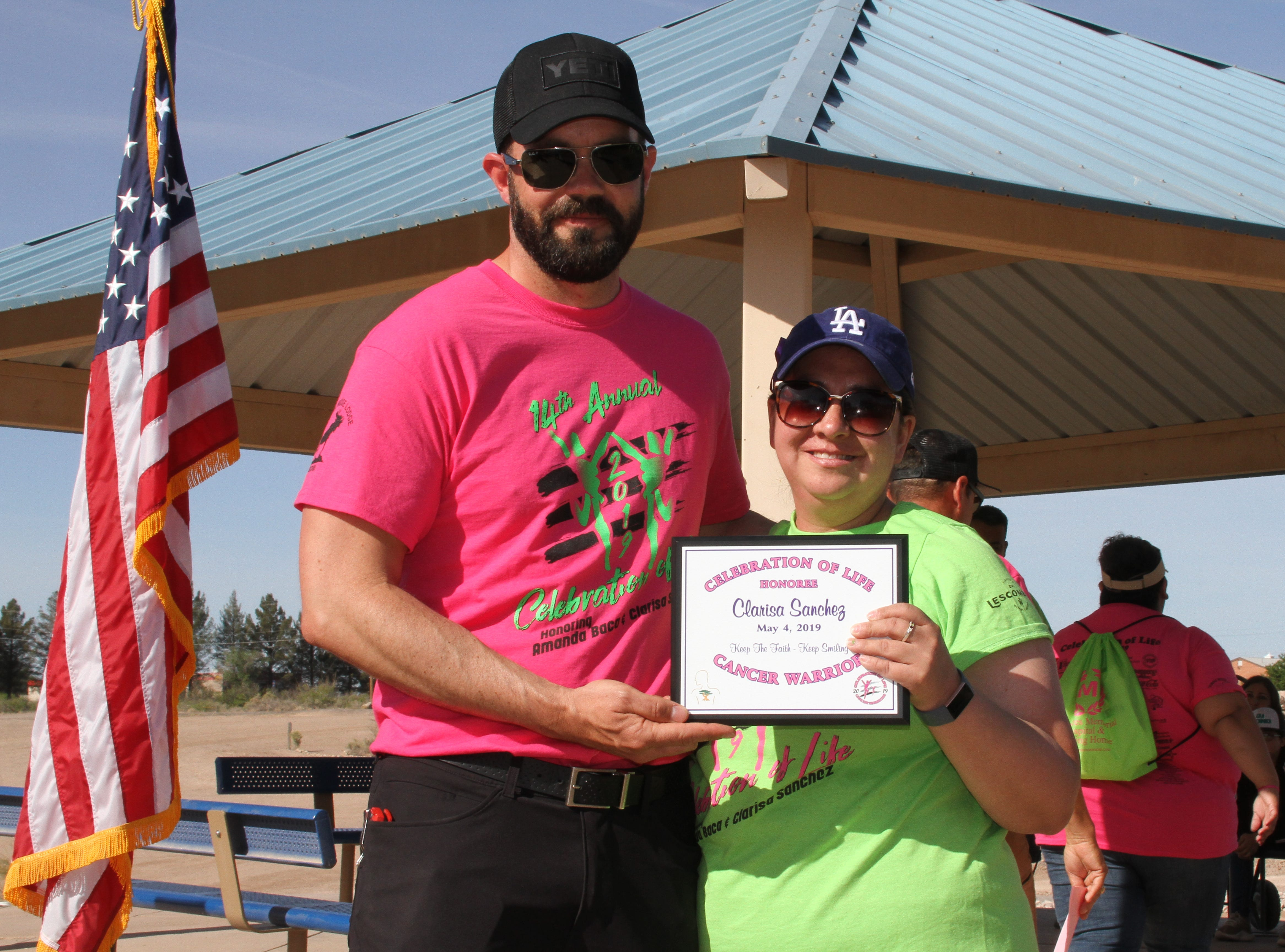 Celebration of Life board member Jarod Hofacket presenting Cancer Warrior Clarrisa Sanchez with an honoree plaque.