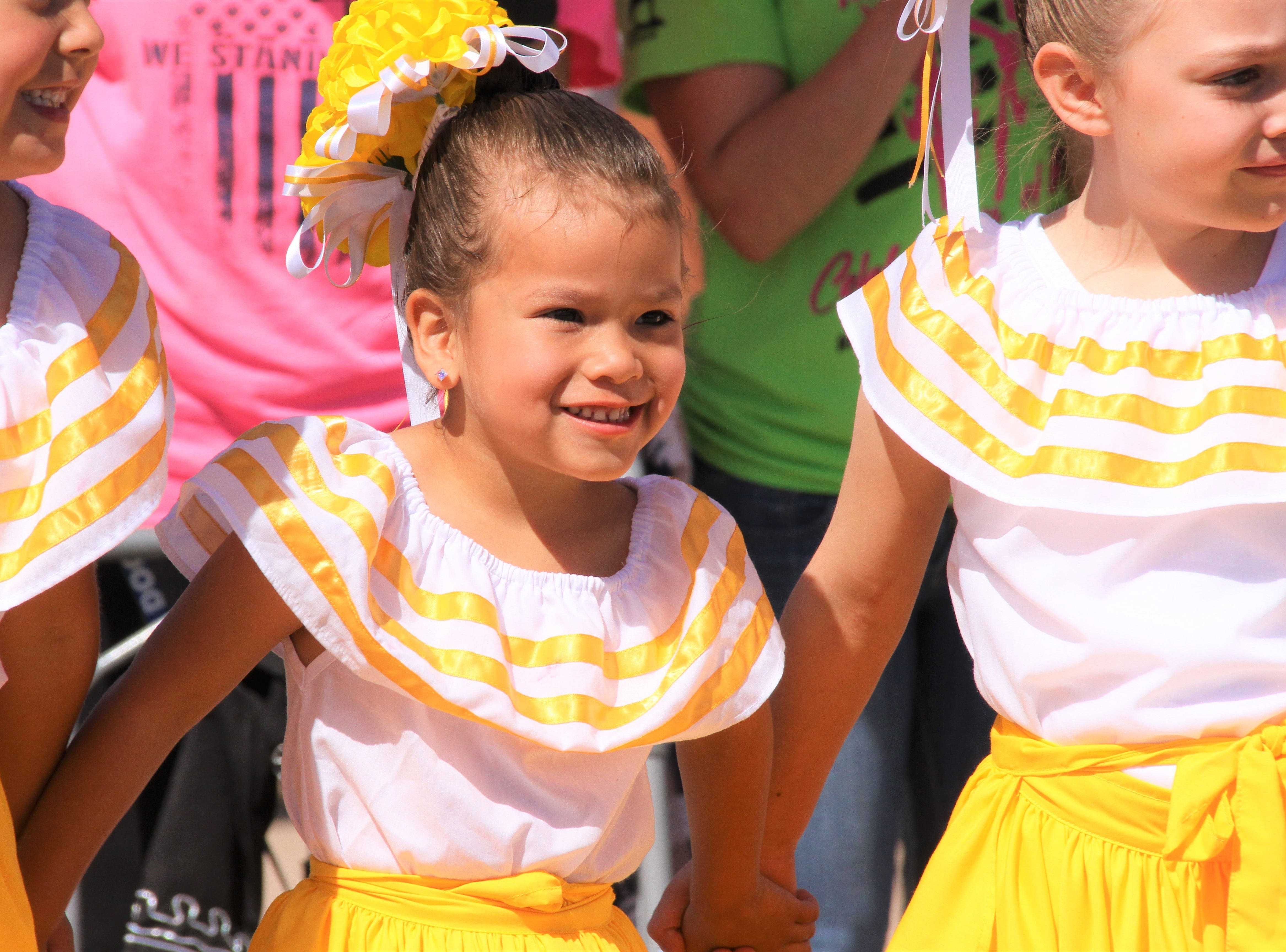 Natalie Costilla was all smiles when she and her Luna Star team danced to children's songs in Spanish at the Celebration of Life walk.