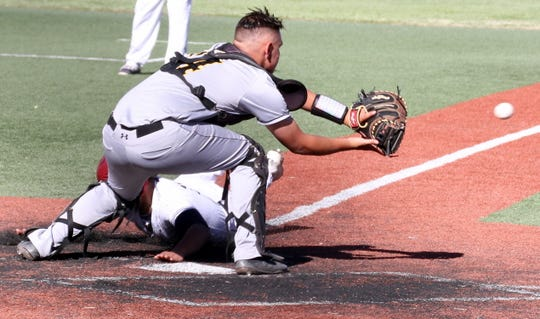 Junior Wildcat James Palomarez sneaks a hand on home plate during Friday's double-header sweep over the Alamogordo Tigers.