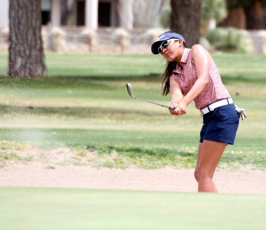Junior Lady 'Cat Mona Magana hits out of the bunker on No. 9 during Monday's District 3-5A Golf Championship at Rio Mimbres Golf Course.