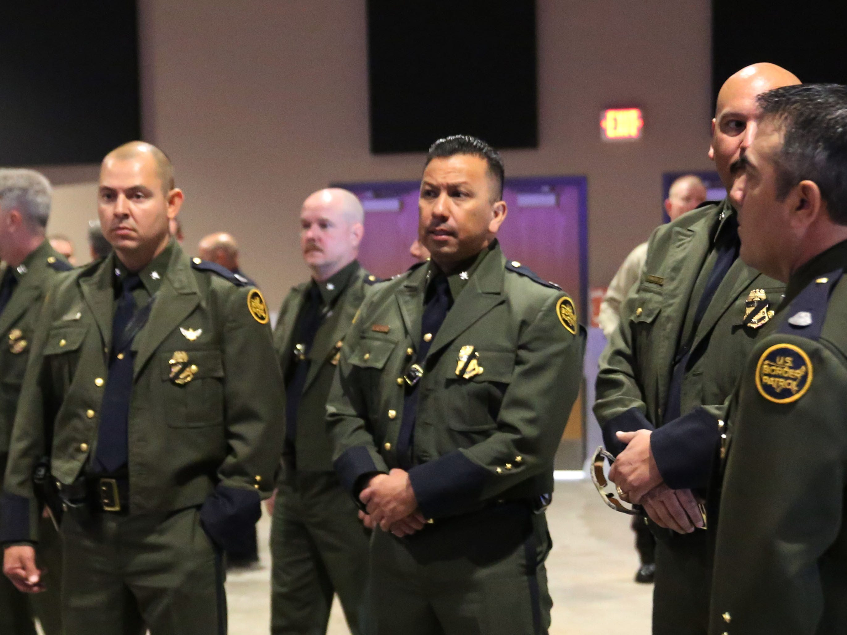 Border Patrol agents wait for a ceremony to begin at the Fallen Officer Memorial in Las Cruces, Tuesday May 7, 2019.