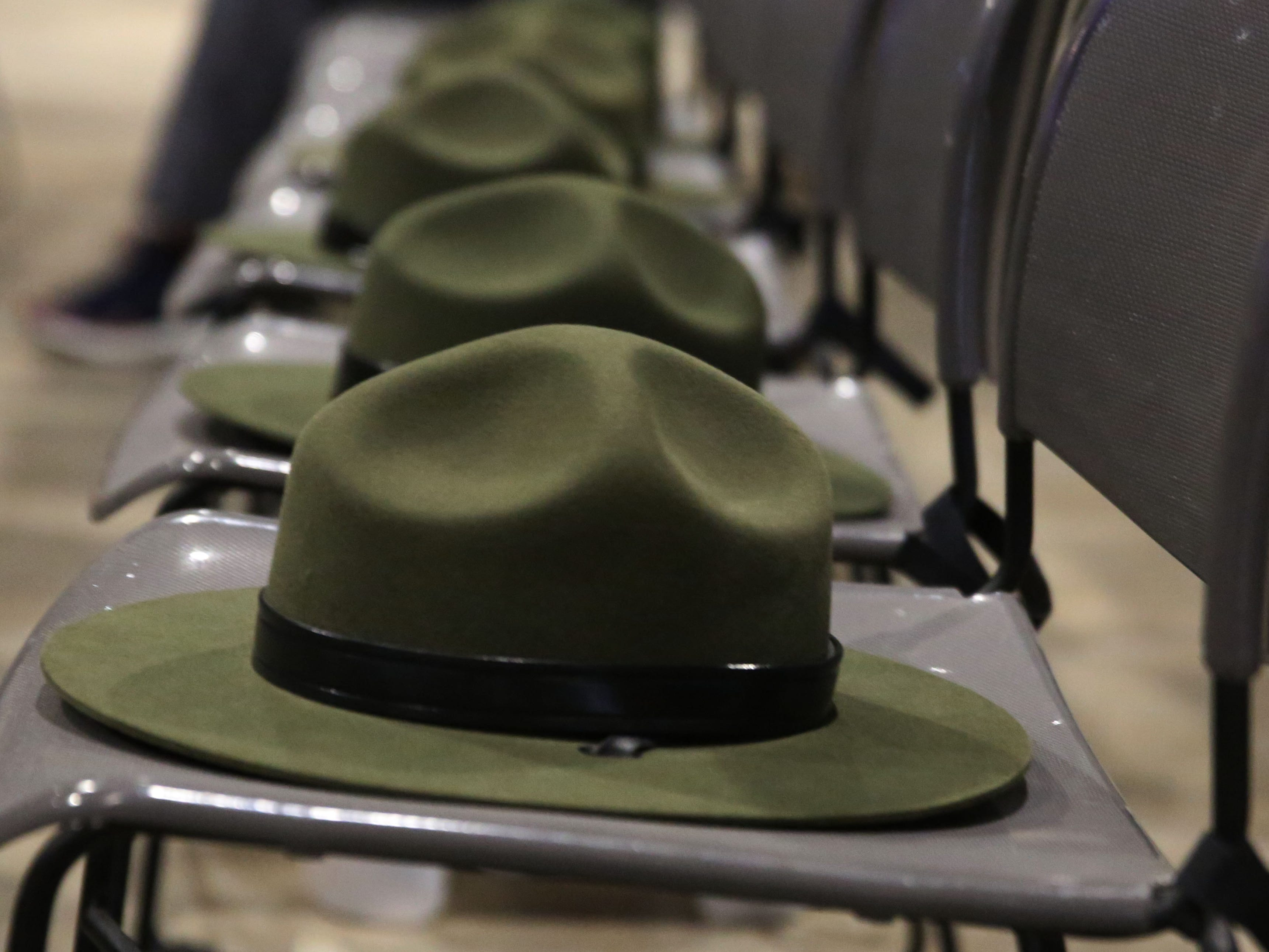 Border Patrol hats line the seats Tuesday May 7, 2019, at Mesilla Park Community Church, during the Fallen Officer Memorial.