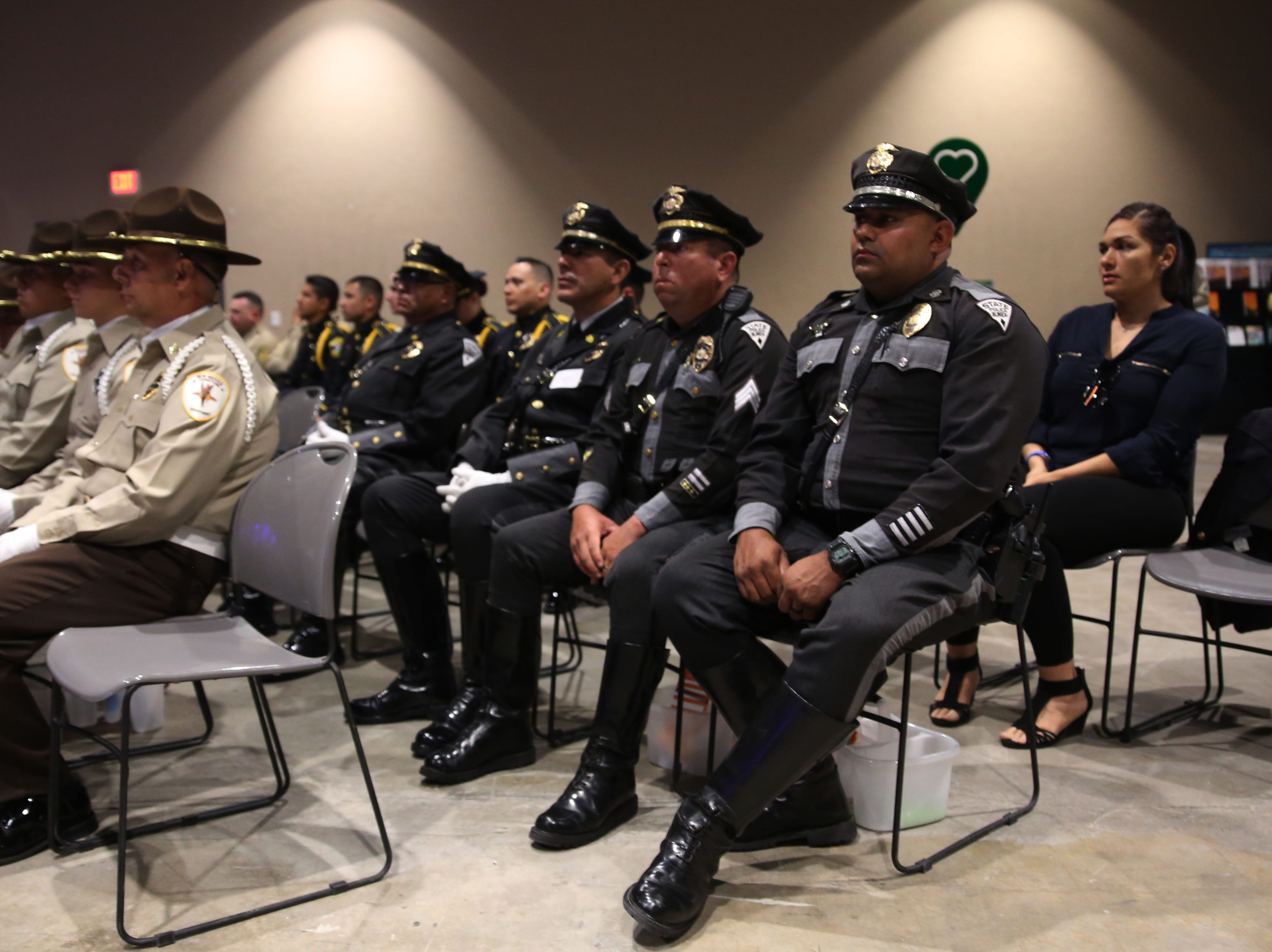 Officers watch the ceremony Tuesday May 7, 2019, at the Fallen Officers Memorial in Las Cruces.