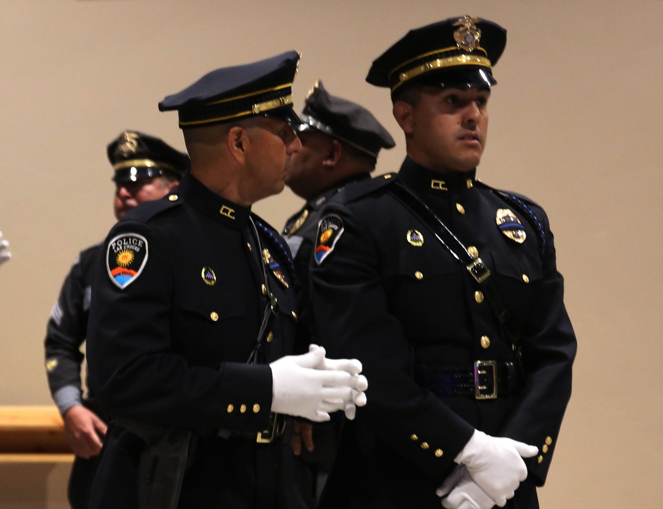 Police officers chat during the Fallen Officer Memorial, Tuesday May 7, 2019, at Mesilla Park Community Church.