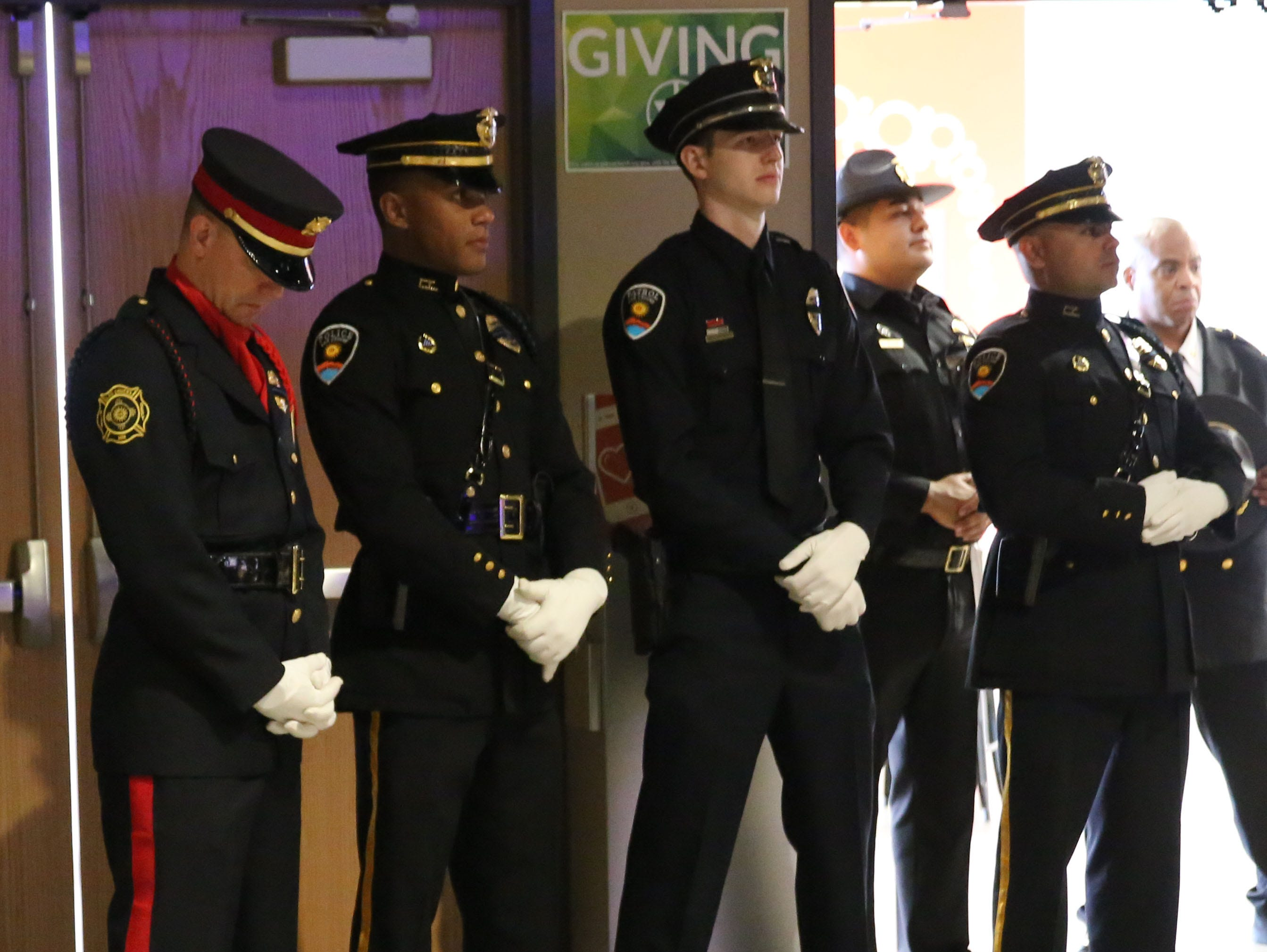 Officers watch a Fallen Officer Memorial ceremony, Tuesday May 7, 2019, in Las Cruces.