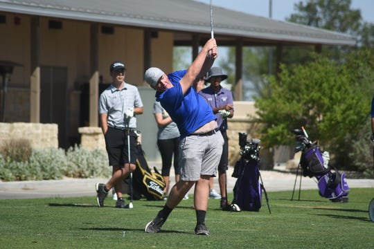 Mason McGee tees off on hole No. 1 Monday morning at Rockwind Community Links during the District 4-5A Golf Tournament.