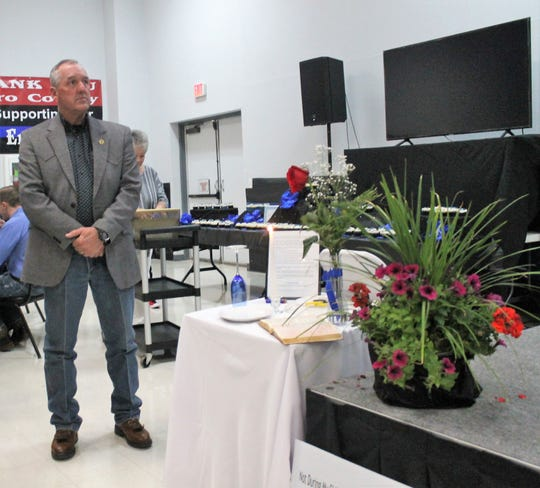 Otero County Sheriff David Black stands next to the empty table set for those law enforcement officers who were killed in the line of duty at the fifth annual Law Enforcement Appreciation Banquet Saturday, May 4.