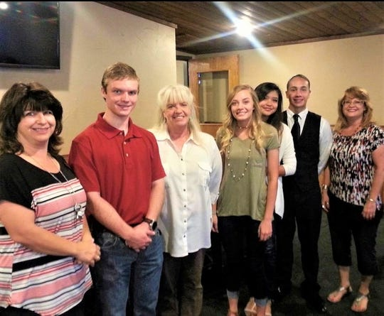 Optimist President Rita Valdez, far right, congratulated winners who received scholarships in a previous year. From left are Optimist member April Rue, and recipients Cameron Treptow, Lendia Adams, Brayden Hall, Irma Allard and Albert Valdez.