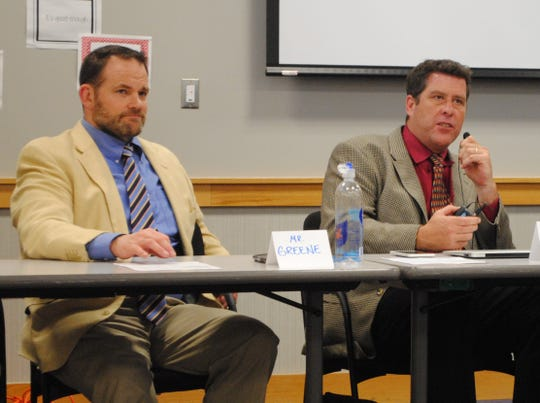 Joe Greene (left) and Tom Shelton, the respective principals of North Farmington and Farmington high schools, at a forum in May.