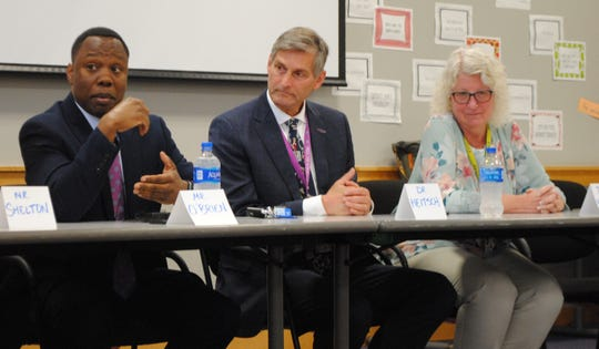 Harrison Principal Chris O'Brien, Superintendent George Heitsch and IB Coordinator Polly Bochroche during Monday's forum.