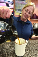 Livonia Breakfast Club waitress Gwen Jacques pours a healthy dose of morning Joe on May 7.