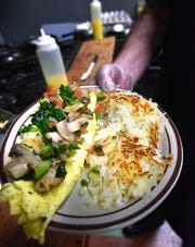 Cacanni presents a vegetable omelette and a side of hash browns.
