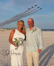 Todd and Michelle Kidwell of West Monroe, Louisiana, after their Orange Beach, Alabama, wedding.