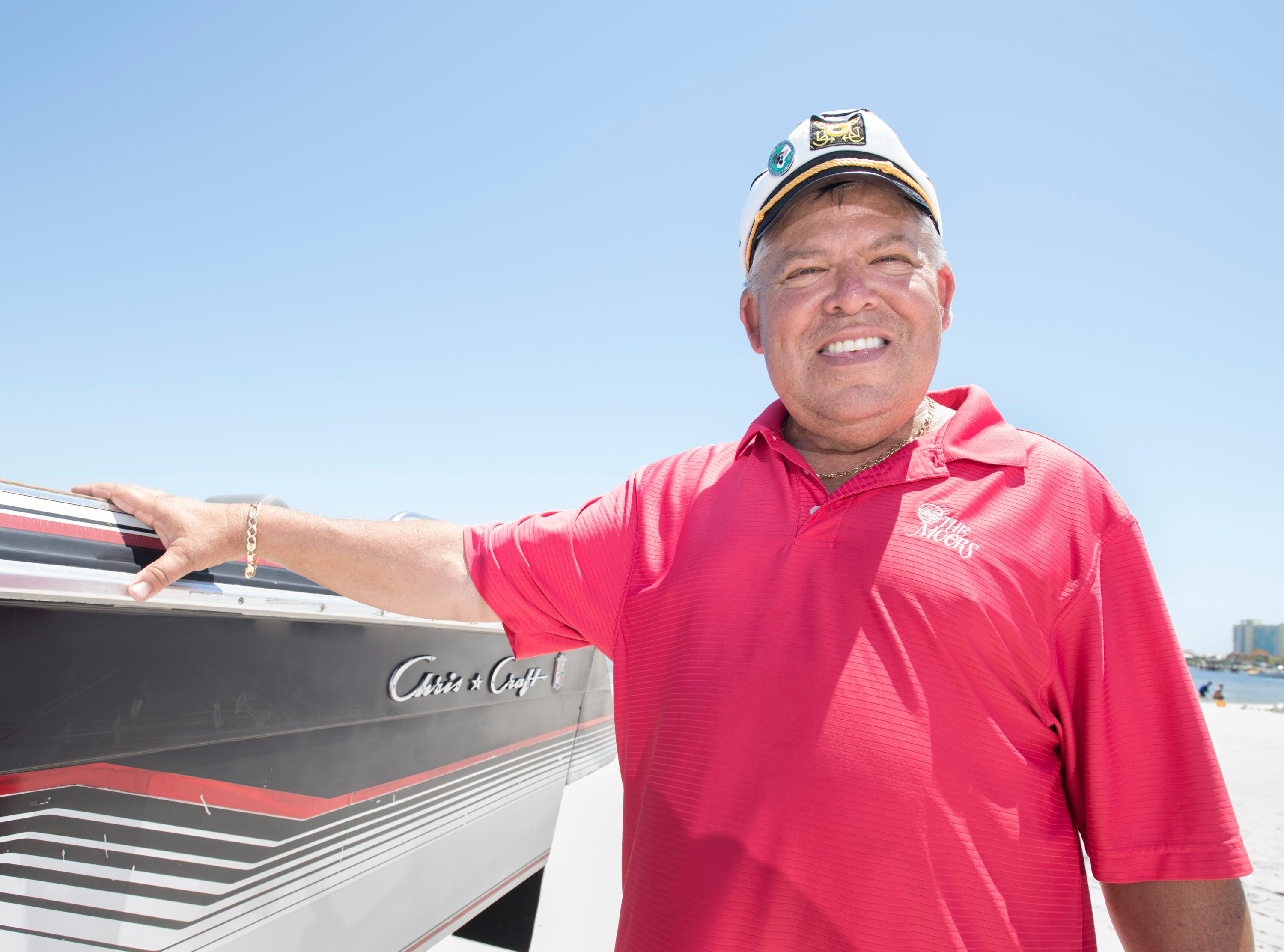 Gerry Moore stands alongside his home-crafted Boat Car in Pensacola on Tuesday, May 7, 2019.  The vehicle is a 1986 Chris Craft 210 Scorpion boat - 2003 Ford Expedition SUV hybrid created by Gerry.