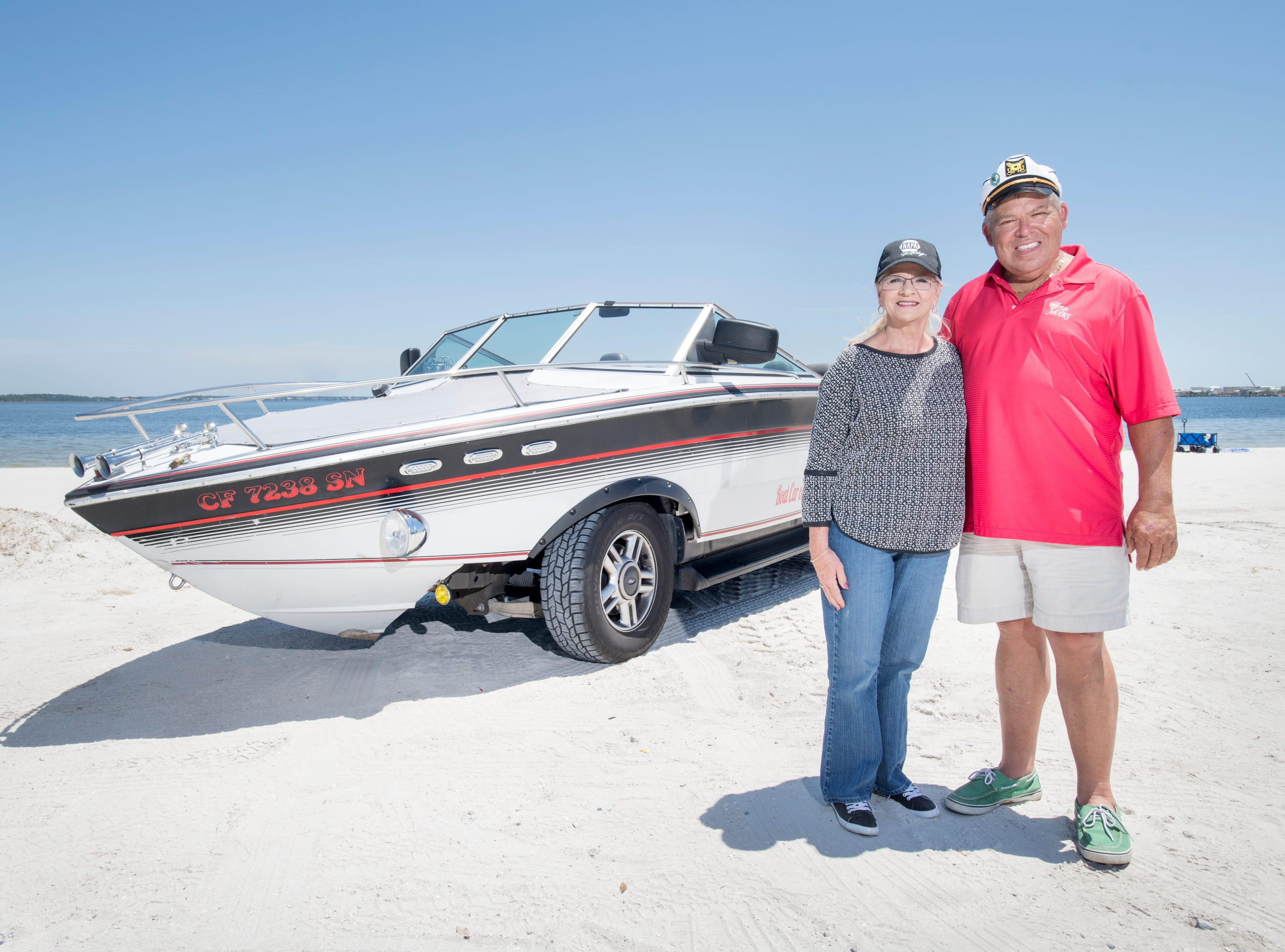 Gerry and Karen Moore cruise alongside their Boat Car in Pensacola on Tuesday, May 7, 2019.  The vehicle is a 1986 Chris Craft 210 Scorpion boat - 2003 Ford Expedition SUV hybrid created by Gerry.