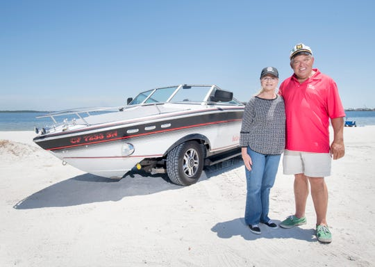 Gerry and Karen Moore stand beside their boat/car on Tuesday.  The vehicle is a 1986 Chris Craft 210 Scorpion boat and a 2003 Ford Expedition hybrid created by Gerry Moore.