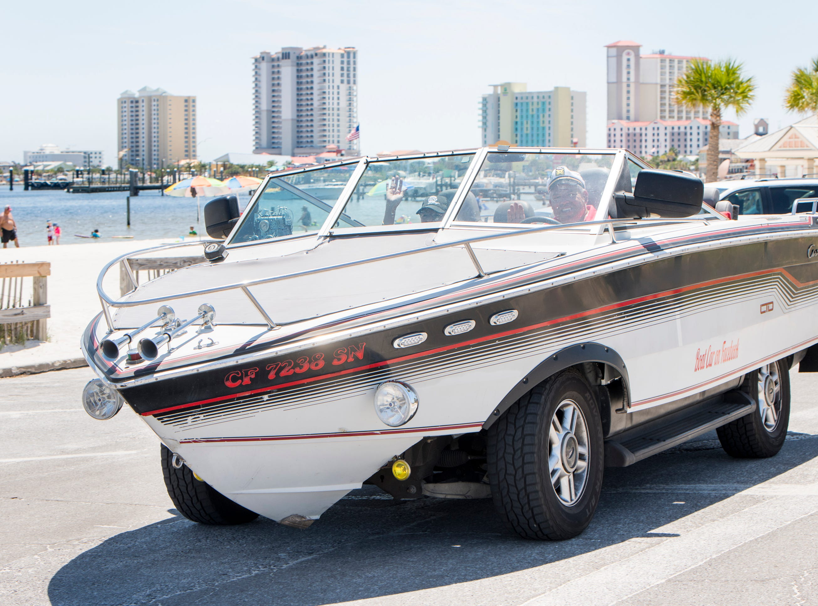 Gerry and Karen Moore drive their Boat Car along Quietwater Beach in Pensacola on Tuesday, May 7, 2019.  The vehicle is a 1986 Chris Craft 210 Scorpion boat - 2003 Ford Expedition SUV hybrid created by Gerry.