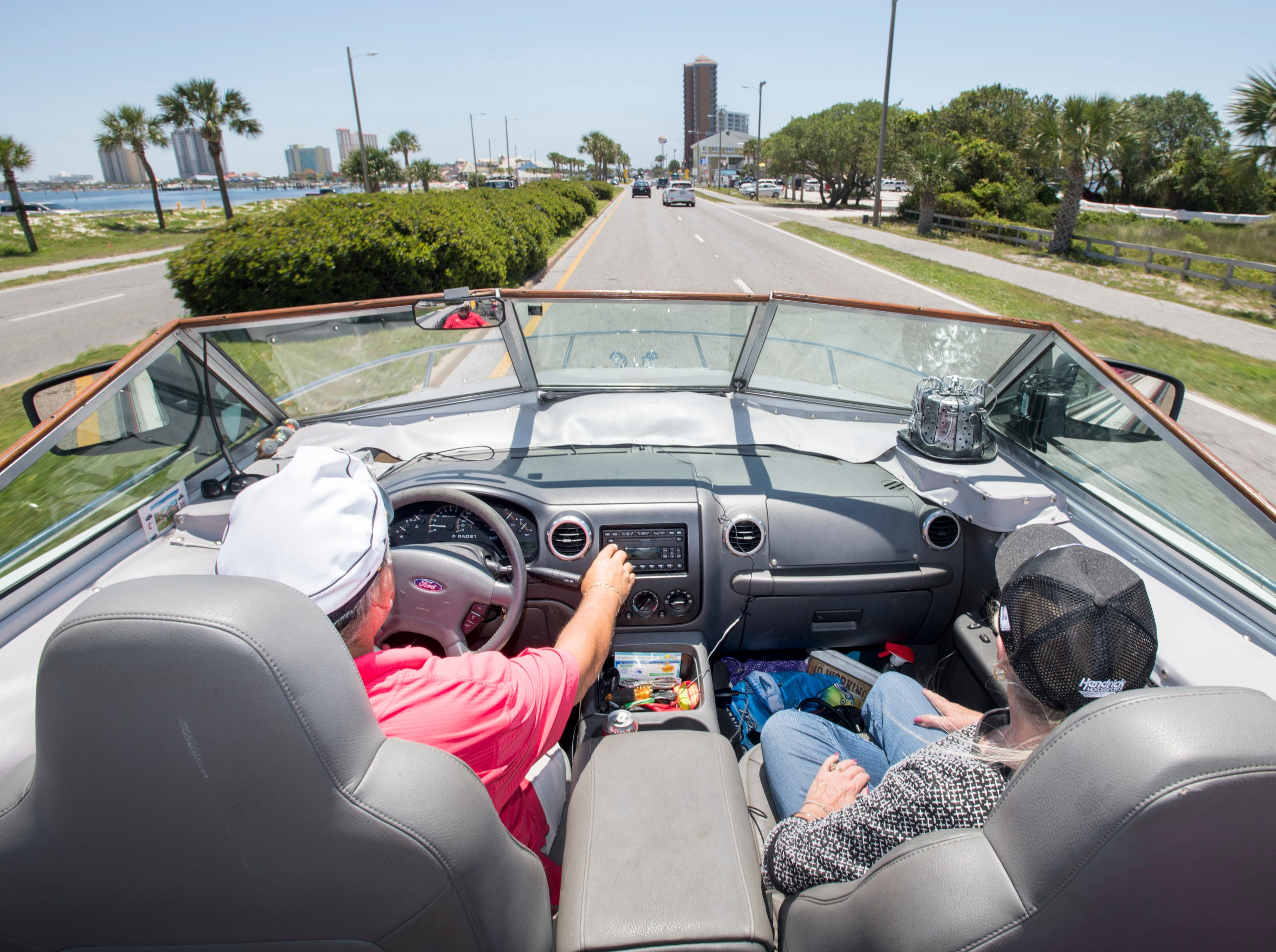 Gerry and Karen Moore cruise along Pensacola Beach Blvd. in their Boat Car in Pensacola on Tuesday, May 7, 2019.  The vehicle is a  1986 Chris Craft 210 Scorpion boat - 2003 Ford Expedition SUV hybrid created by Gerry.