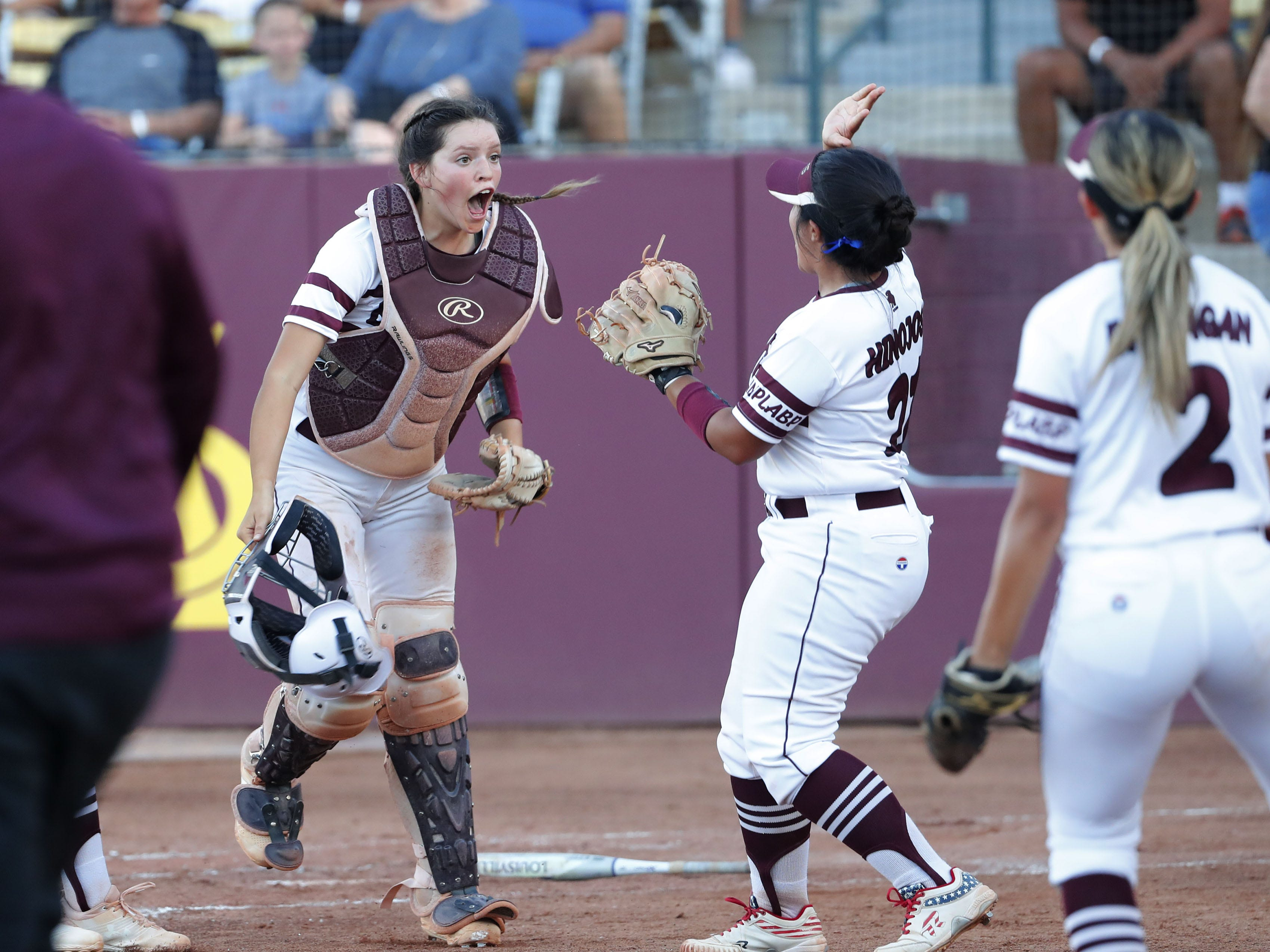 Ray catcher Tara Loroña (13) celebrates an out play at home with pitcher Daniella Hinojos (21) against Superior during the 1A softball state championship game in Tempe May 6, 2019.