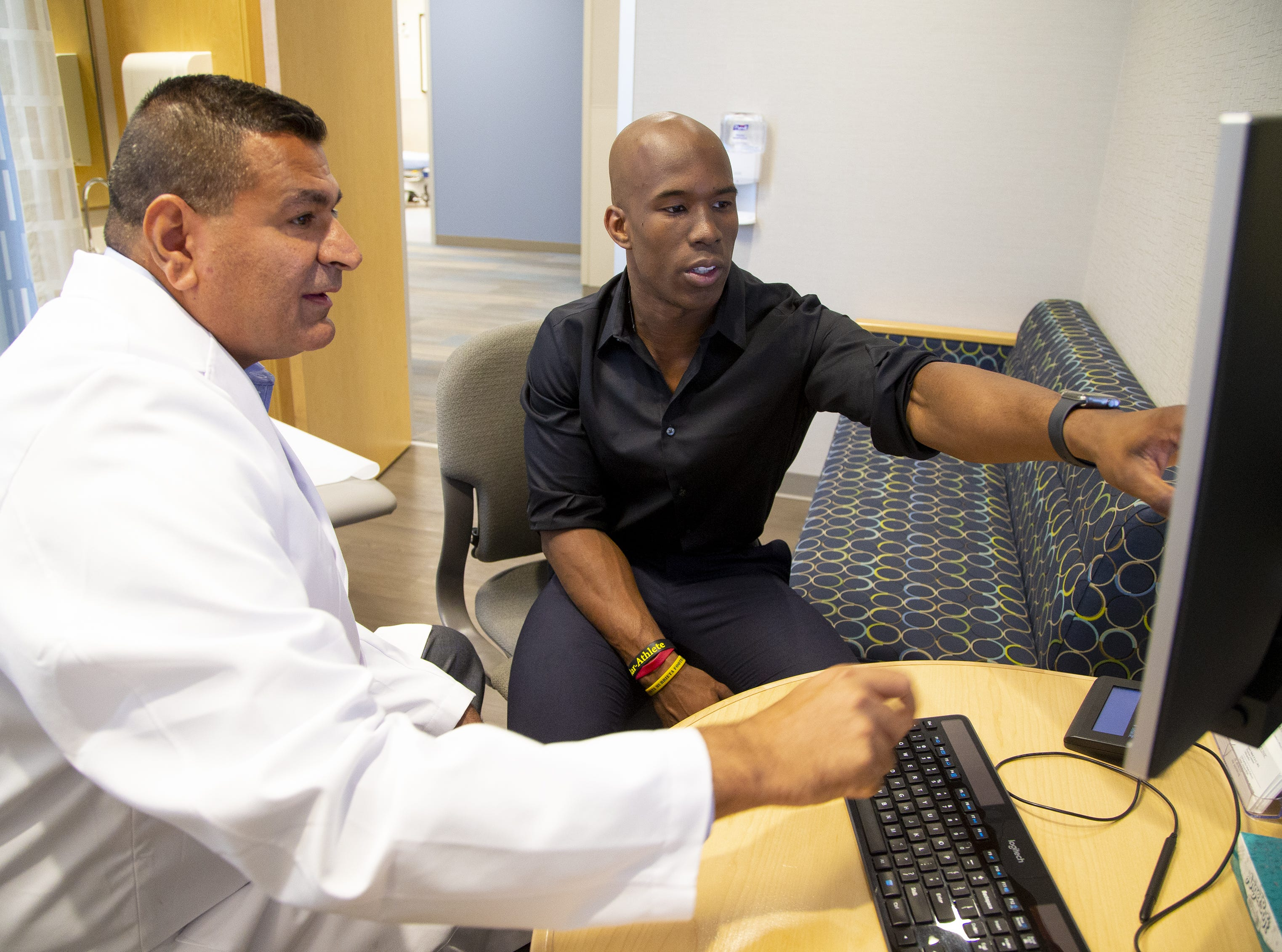 ASU football wide receiver Kyle Williams was introduced to Dr. Anikar Chhabra, director of sports medicine at Mayo Clinic and ASU team physician, after an injury. Williams prepares for his own career in medicine assisting Chhabra in his research.